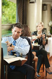 Businessman waiting in cafe Stock Photos
