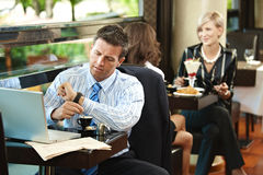 Businessman waiting in cafe Stock Image