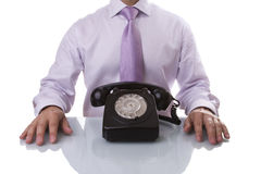 Businessman waiting for a call Stock Photography