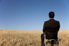 Businessman waiting at the field Royalty Free Stock Image