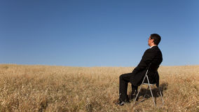 Businessman waiting at the field Stock Image