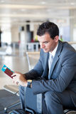 Businessman waiting for flight Royalty Free Stock Image