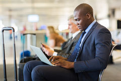 Businessman waiting flight Stock Image