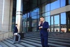 Businessman waiting for his colleague outside looking at the watch. Royalty Free Stock Image