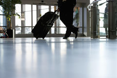 Businessman waiting with luggage in airport Royalty Free Stock Photos