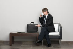 Businessman in the waiting room Royalty Free Stock Photography