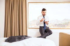Businessman waking up with some coffee Stock Photo