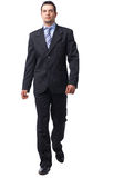 Businessman Walking. Full length portrait of a confident businessman walking isolated on white Stock Photo