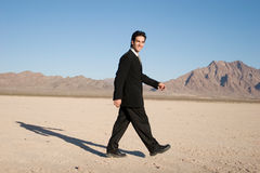 Businessman walking Royalty Free Stock Images