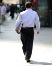 Businessman walking. On a busy street downtown Royalty Free Stock Photography
