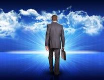 Businessman walking against blue landscape with Stock Photos