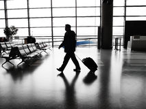 Businessman walking in airport stock images