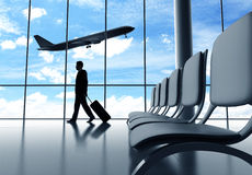 Businessman walking in airport Royalty Free Stock Image