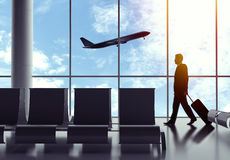 Businessman walking in airport Royalty Free Stock Images