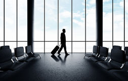 Businessman walking in airport Stock Photo