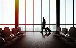 Businessman walking in airport Stock Image