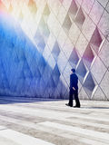Businessman walking in architectural design buildings Stock Photos