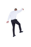 Businessman walking with arms up Stock Photography