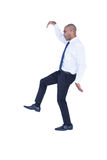 Businessman walking with arms up Stock Images