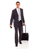 Businessman walking bag. Businessman walking with trolley bag and passport Royalty Free Stock Photos