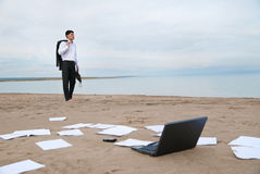 Businessman walking on beach Royalty Free Stock Photography