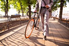 Businessman walking with bicycle royalty free stock image