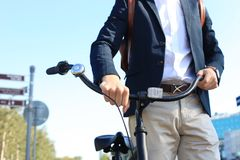 Businessman walking with bike in street after work. Stock Photography