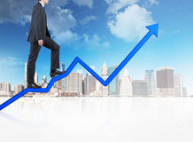 Businessman walking on blue chart Stock Photos