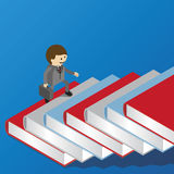 Businessman is walking on book ladder Royalty Free Stock Images