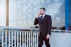 Businessman walking on bridge Royalty Free Stock Images