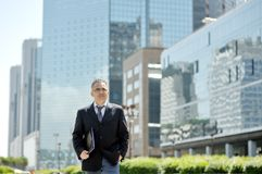 Businessman walking in business center Royalty Free Stock Photo