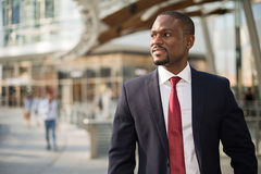 Businessman walking in a business environment. Portrait of an handsome businessman walking in a business environment royalty free stock photography