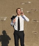 Businessman walking and calling by mobile phone Royalty Free Stock Image