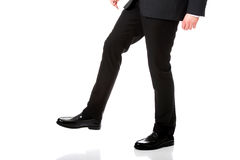 Businessman walking carefully. Royalty Free Stock Photos