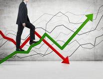 Businessman walking on chart Royalty Free Stock Photo