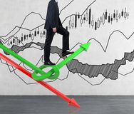 Businessman walking on charts Royalty Free Stock Photos