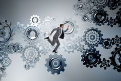 The businessman walking on cogwheels in teamwork concept Royalty Free Stock Image