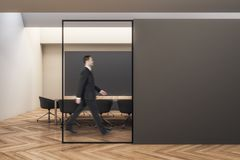 Businessman walking in contemporary meeting room royalty free stock photo