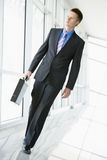 Businessman walking in corridor Royalty Free Stock Photo
