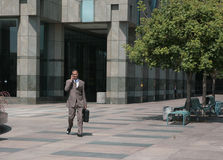 Businessman Walking Through Courtyard Royalty Free Stock Photography
