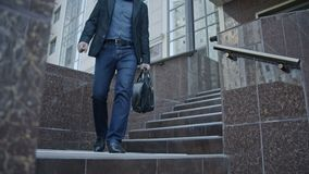 Businessman Walking Down The Stairs With His Bag stock footage
