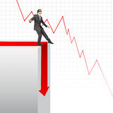 Businessman walking on edge of chart Stock Images