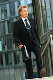 Businessman walking with folder Stock Photography