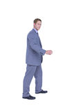 Businessman walking while gesturing with hands Royalty Free Stock Image
