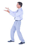 Businessman walking while gesturing with hands Royalty Free Stock Images