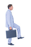 Businessman walking while gesturing with hands Stock Photo