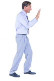 Businessman walking while gesturing with hands Royalty Free Stock Photos