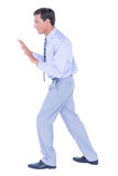 Businessman walking while gesturing with hands Stock Photos