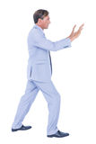 Businessman walking while gesturing with hands Royalty Free Stock Photo