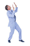Businessman walking while gesturing with hands Stock Image